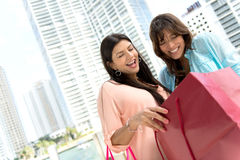 Shopping women looking at bags Stock Images