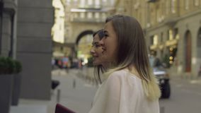 Shopping women looking at shop window display outside stock footage