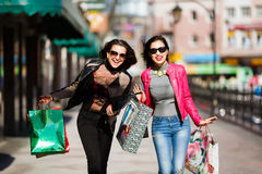 Shopping women outdoors Stock Photo