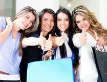 Shopping women with thumbs up Royalty Free Stock Photos