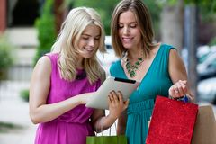 Shopping Women Using Digital Tablet Royalty Free Stock Images