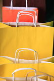 Shopping yellow gift bags on black background Royalty Free Stock Photography