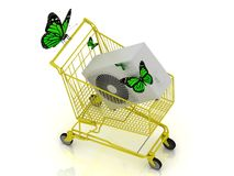 Shopping yellow trolley in high definition with green butterfly Royalty Free Stock Images