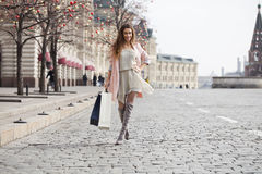 Shopping. Young beautiful brunette woman Royalty Free Stock Photography