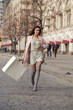 Shopping. Young beautiful brunette woman Royalty Free Stock Images