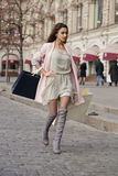 Shopping. Young beautiful brunette woman. In beige dress and pink coat Stock Photo