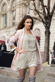 Shopping. Young beautiful brunette woman Royalty Free Stock Photos