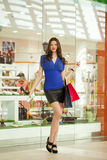 Shopping, Young beautiful woman on the background showcases a sh Stock Photos