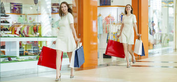 Shopping, young beautiful women on the background showcases a sh Stock Images