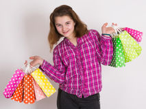 Shopping. Young girl with shopping bags Stock Images