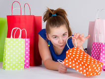 Shopping. Young girl with shopping bags Royalty Free Stock Photography
