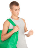 Shopping young man with green ecological bag Royalty Free Stock Photography