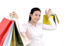 Shopping young woman. Shopping smiling young woman holding bags. Young woman and christmas shopping series Royalty Free Stock Image