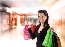 Shopping young woman Stock Images