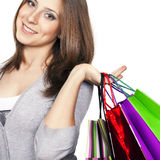 Shopping. Young woman with shopping bags in hand Stock Photos