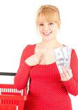 Shopping young woman with dolars Stock Images
