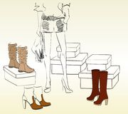 Shopping. Young woman shopping for fashion shoes Royalty Free Stock Photos