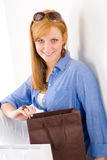 Shopping young woman with paper bag Royalty Free Stock Image