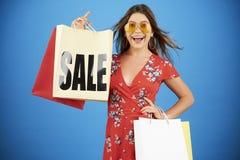Shopping young woman stock photos