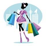 Shoppingflicka i stad Arkivbilder