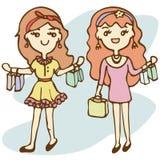 Shoppingflickor med shopping hänger lös Royaltyfri Foto