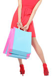 Shoppingkvinnaben och påse Fotografering för Bildbyråer