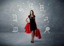 Shoppingkvinnlig med påsar och utdragna symboler Fotografering för Bildbyråer