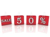 Shoppingpåsar med meddelandeförsäljning och 50 procent Arkivbilder