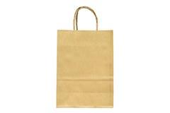 Shoppingpåse för brunt papper med handtag över på vit bakgrund Royaltyfri Foto