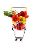 Shoppingspårvagn och grönsaker Arkivfoto