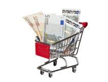 Shoppingvagn med euroet som isoleras på vit Royaltyfria Foton