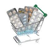 Shoppingvagn med olika preventivpillerar i en blåsapacke Royaltyfri Fotografi
