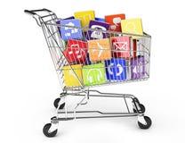 Shoppingvagn med symboler för applikationprogramvara Arkivfoto