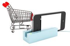 Shoppingvagn med telefonen i kortläsare fotografering för bildbyråer