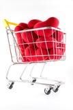 Shoppingvagn och många röda hjärtor Royaltyfria Bilder
