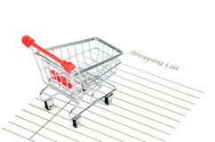 Shoppingvagn och shoppinglista arkivfoto
