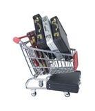 Shoppingvagn som fylls med portföljer Royaltyfri Foto