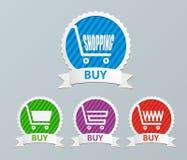 Shoppingvagnen - köp symboler Arkivfoton
