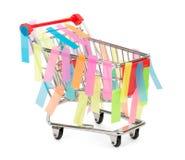 Shoppong-Warenkorb mit Aufklebern Stockfoto