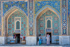 Shops in atrium of Registan, Samarkand, Uzbekistan. SAMARKAND, UZBEKISTAN - Small souvenir shop in the colorful atrium in Samarkand Registan, Uzbekistan. August Royalty Free Stock Images