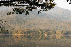 Shops by beautiful lake, water reservoir by natural mountain Stock Photography