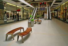 Shops, benches, escalators. Trade centre with escalators and benches Stock Photography
