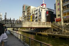 The shops on the both sides of Dotonbori Canal. Shinsaibashi is a district in the Chuo-ku ward of Osaka. Osaka, Japan, 29th, May, 2017. The shops on the both royalty free stock photos