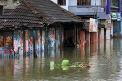 Shops and buildings are submerged in the flood water stock photography