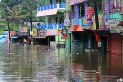 Shops and buildings are submerged in the flood water stock images