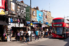Shops in Camden Town in London. Tourists and locals walk in Camden Town, London on August 21, 2013. Camden Town is London's most popular open-air market area Stock Photo