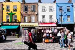 Shops in Camden Town, London. Tourists and locals walk past stalls and shops in Inverness St in Camden, London on August 21, 2013. Once a fresh produce and Stock Photos