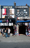 Shops in Camden Town, London. Tourists stands in front of a shoe's store in Camden Town, London on August 21, 2013. Camden Town is London's most popular open-air Royalty Free Stock Images