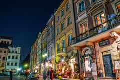 Shops on city street at night, Poland