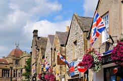 Shops with flags, Bakewell. Royalty Free Stock Image